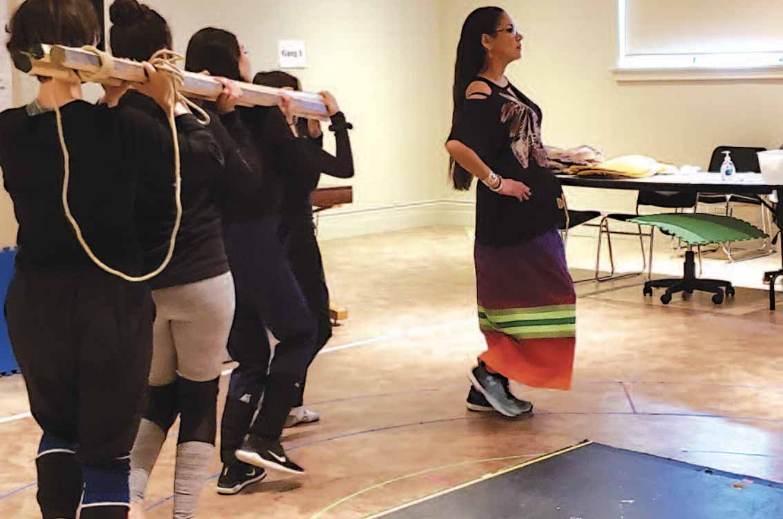 Mandy Goforth leads other female performers during rehearsals at the Globe Theatre production of Making of Treaty 4.