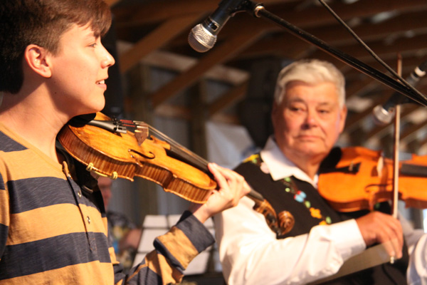 Tristan Durocher played a special tune with his teacher John Arcand.