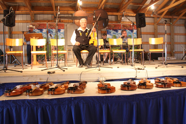 The legend centre stage with his fiddles that were to be played in concert.