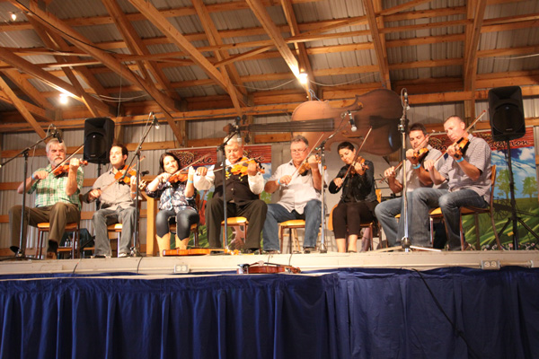 John and all the Fiddle Fest instructors play a concert using only fiddles made by the Metis fiddle master himself.