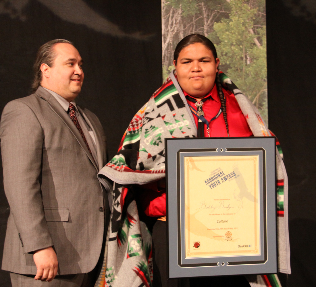 Bobby Badger received the Culture award from SIGA Vice President Lionel Tootoosis.
