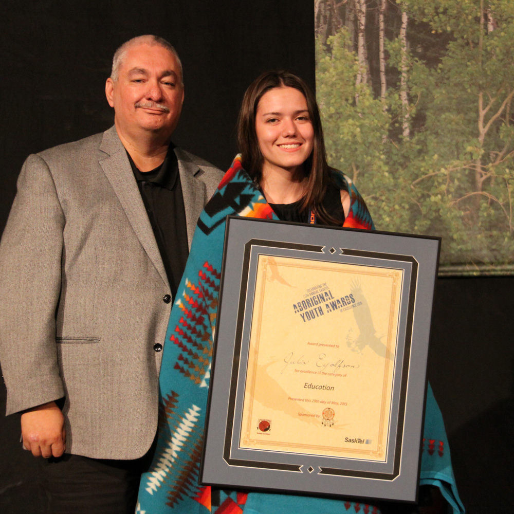 Julia Eyolfson received the Education award from Richard Ahenakew of the Northern Lights Casino.