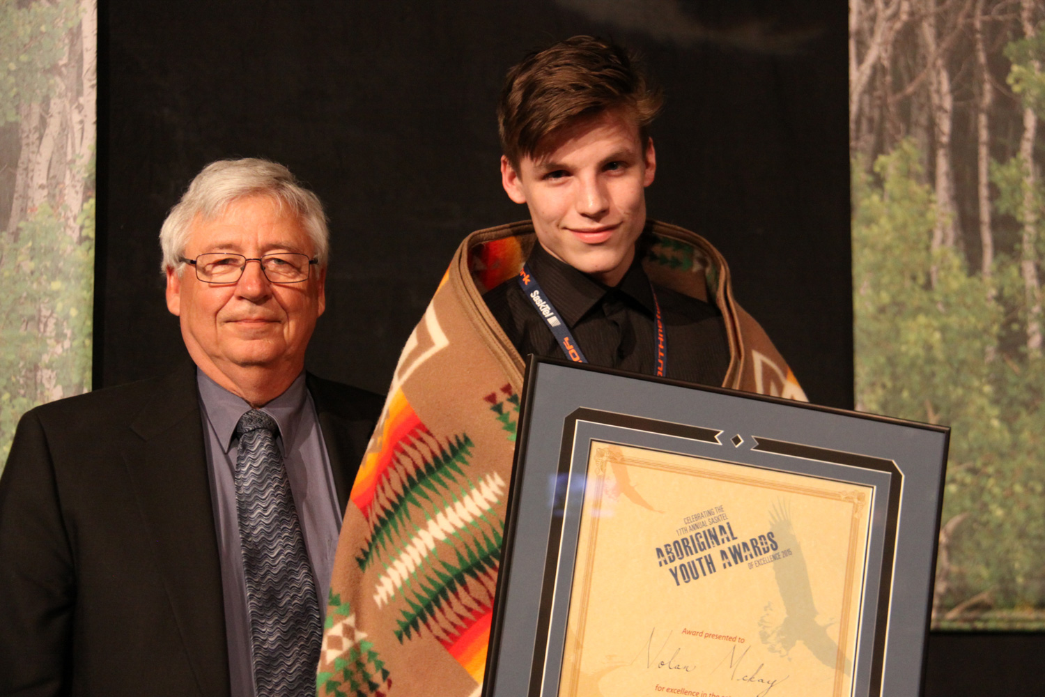 Boxer Nolan McKay received the Male Sport award from Jerry Shoemaker of SaskSport.
