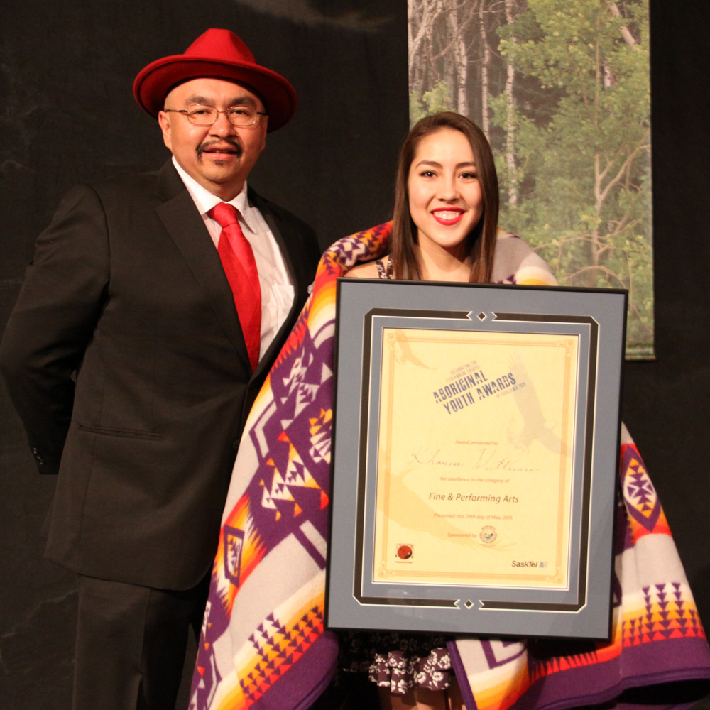 Khoniss Wuttunee received the Fine/Performing Arts award from Merv Brass of MBC Radio.