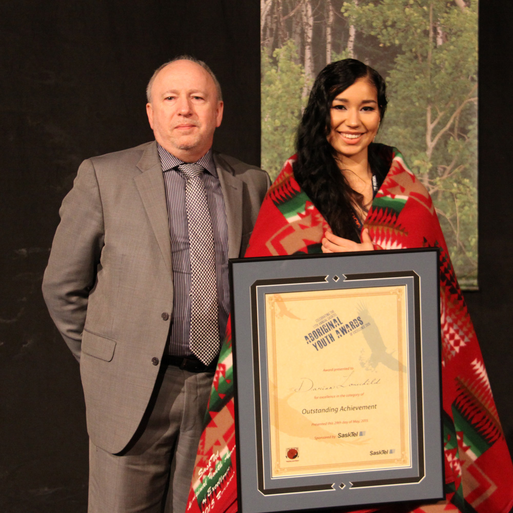 Darian Lonechild received the Female Outstanding Achievement award from SaskTel President Ron Styles.