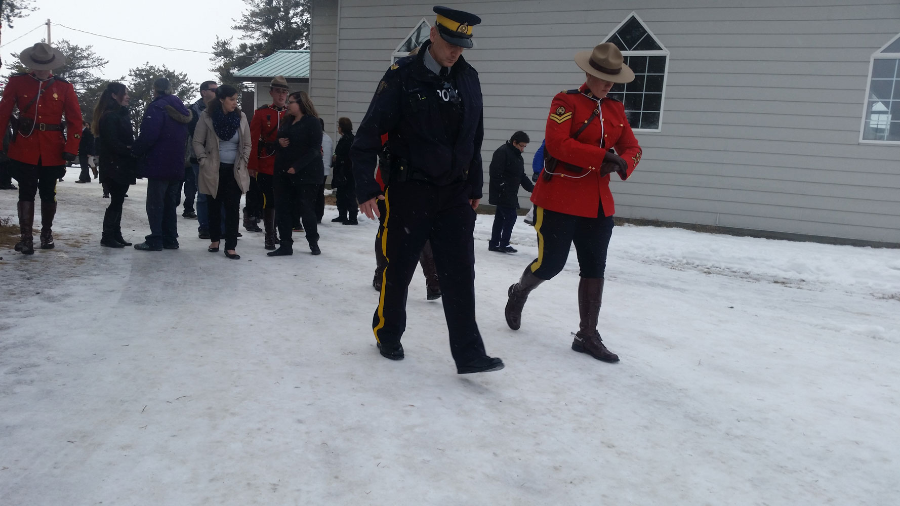 Mourners, including RCMP, at Marie Janvier's funeral.
