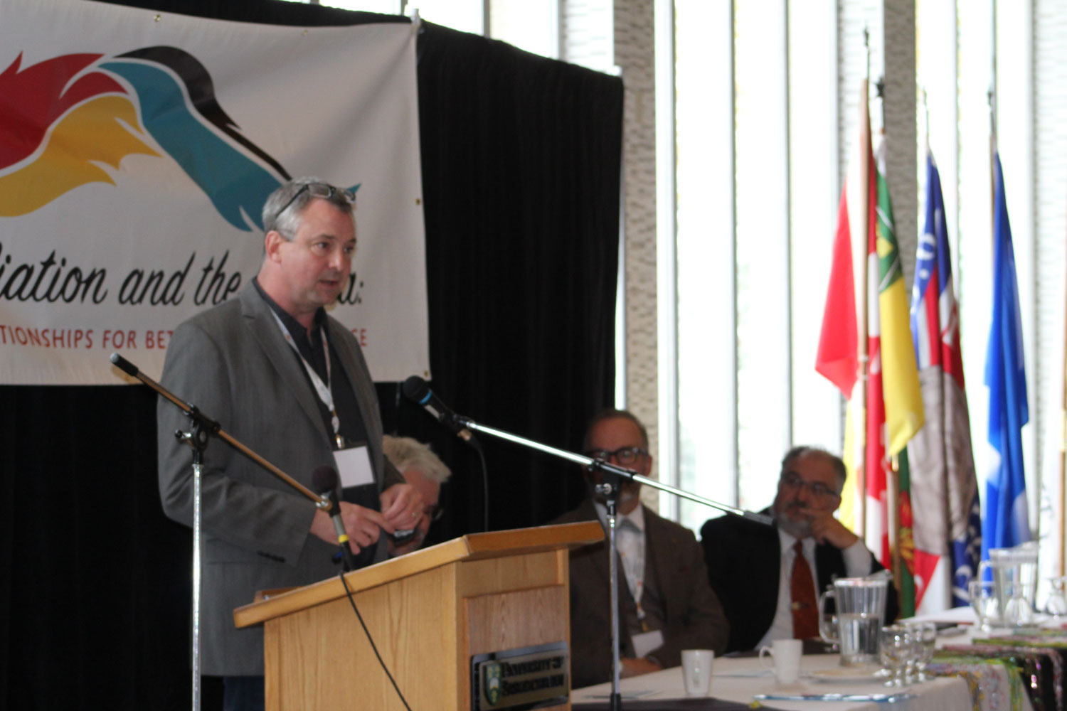 John Lagimodiere speaking during a panel discussion.
