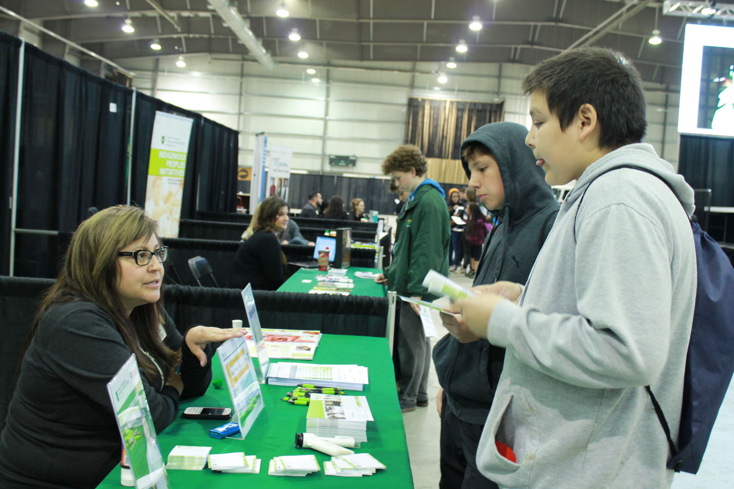 Students visiting the SaskTel booth.