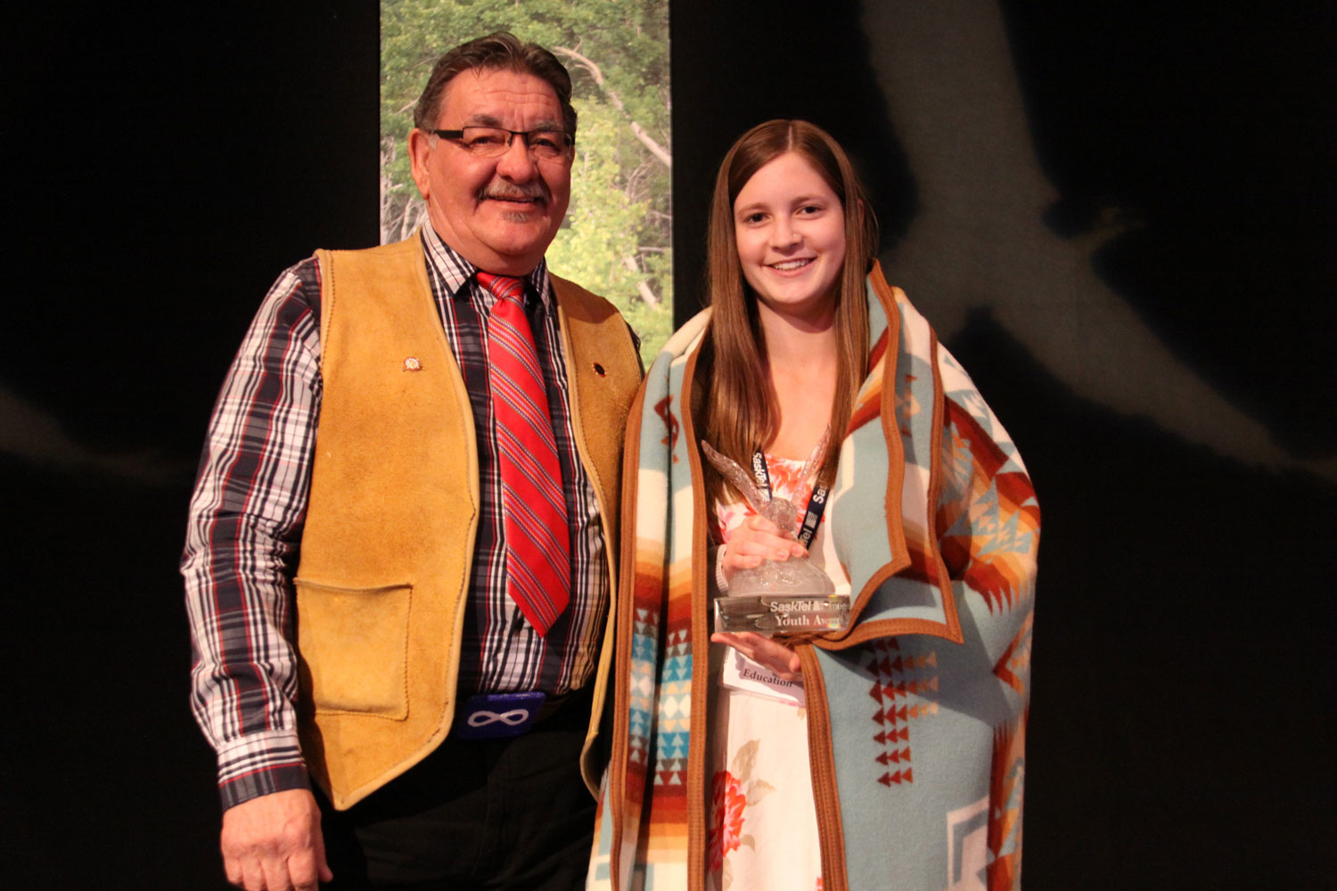 Norman Fleury of the U of S presented the Education award to Chelsea Cooke