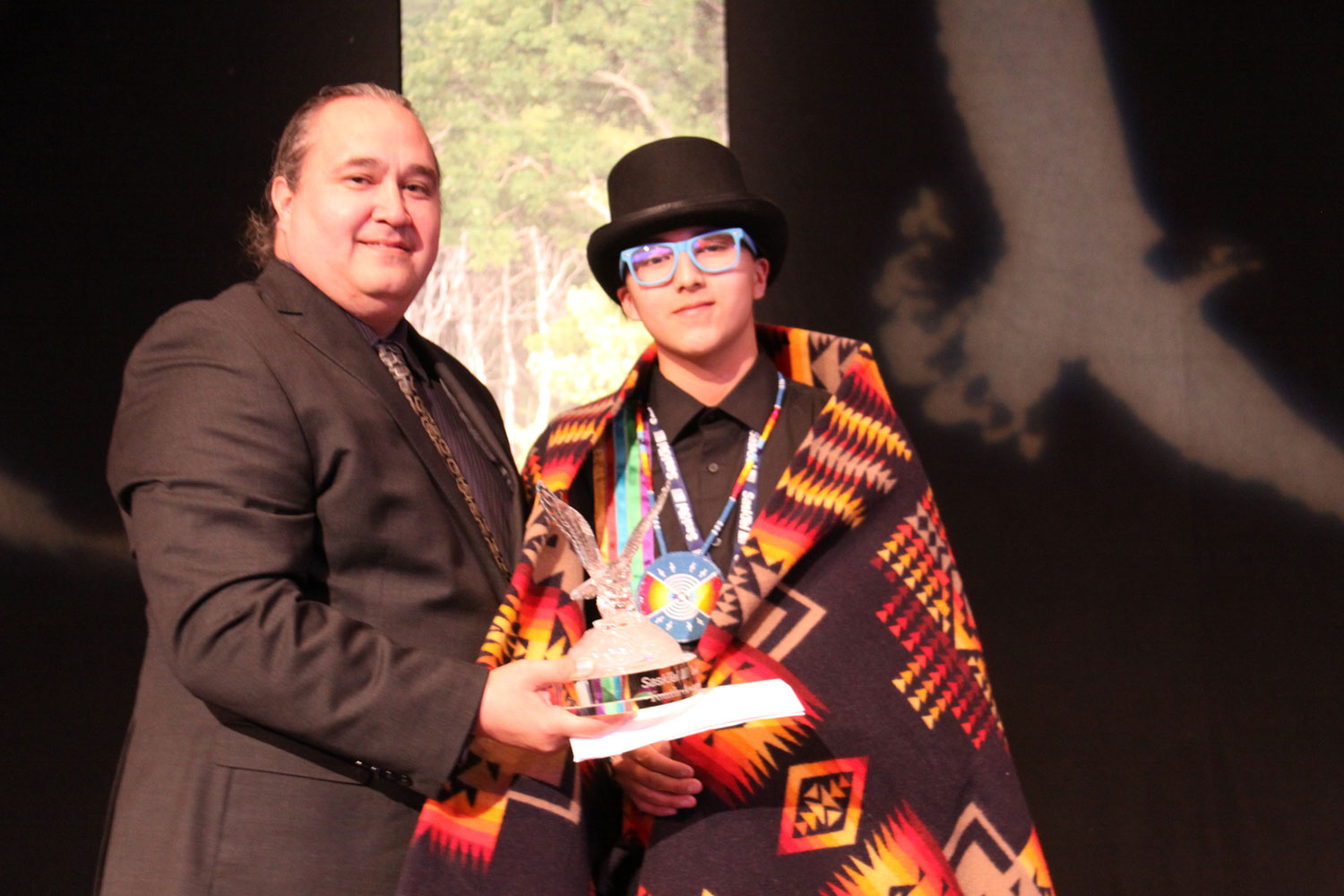 Lionel Tootoosis of SIGA presented the Culture award to Bluejay Linklater