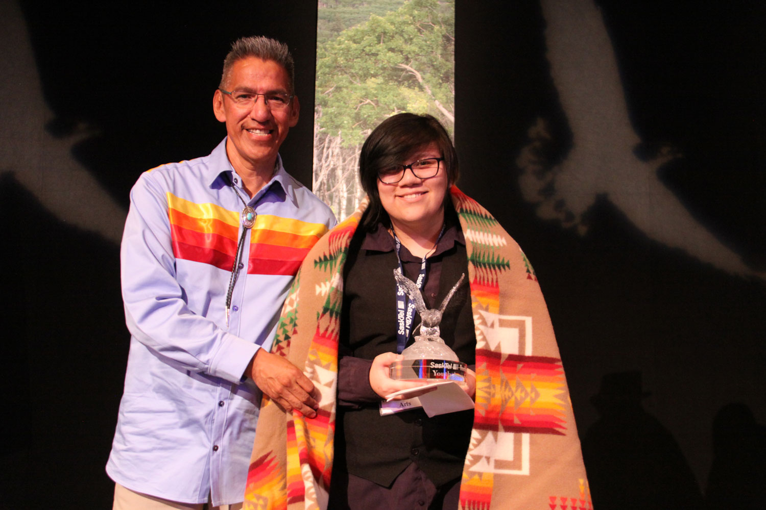 Lyle Daniels of Sask Building Trades presented the Fine/Performing Arts award to Aiyanna Glenister