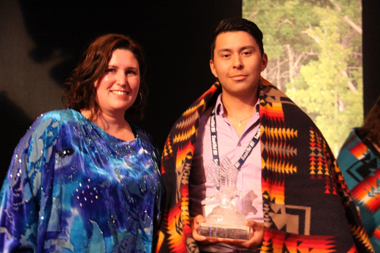 Tavia Laliberte of SaskSport presented the Sports award to Landon Sasakamoose
