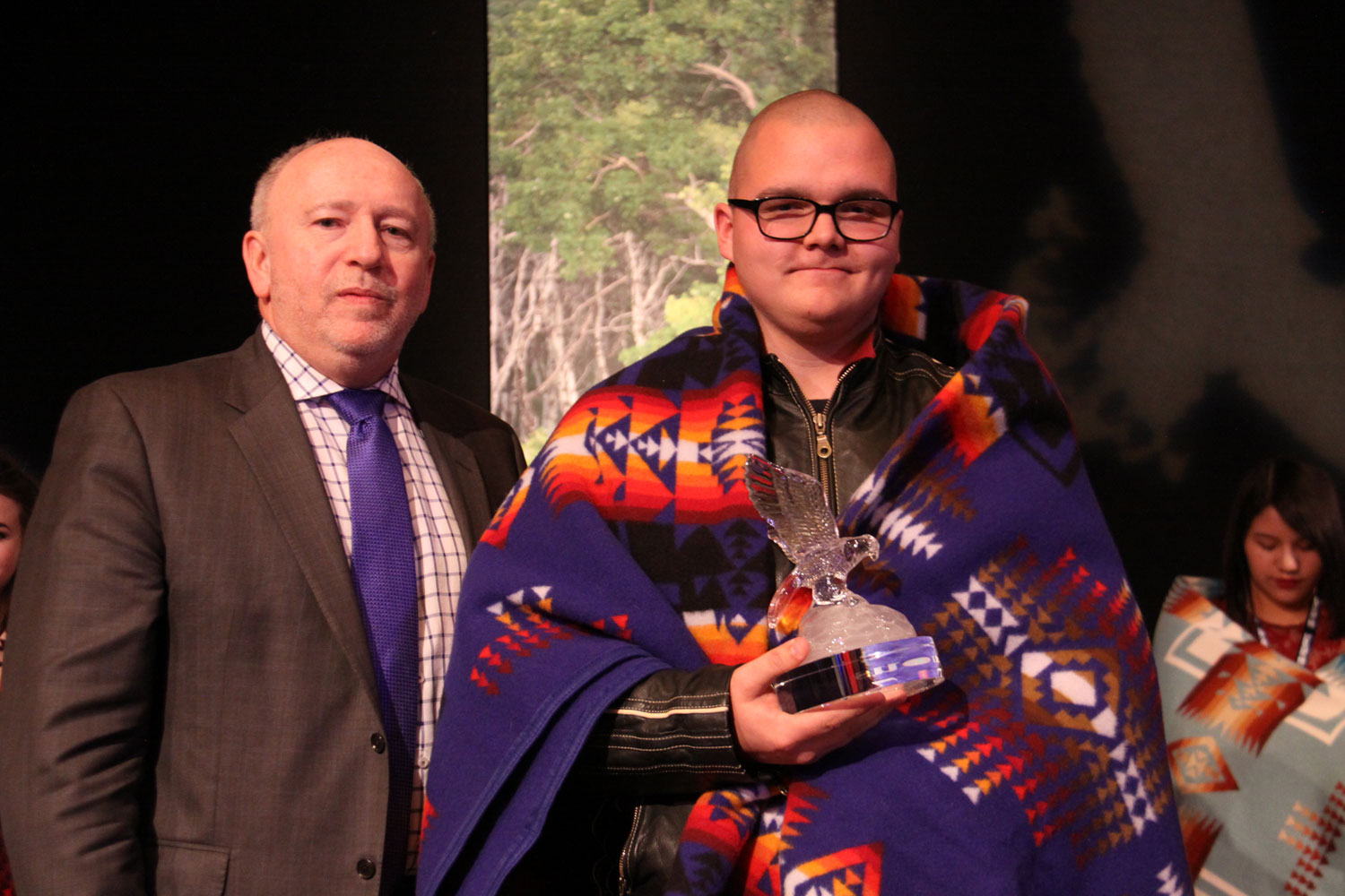 Ron Styles of SaskTel presented the Male Outstanding Achievement award to Brayden Storm