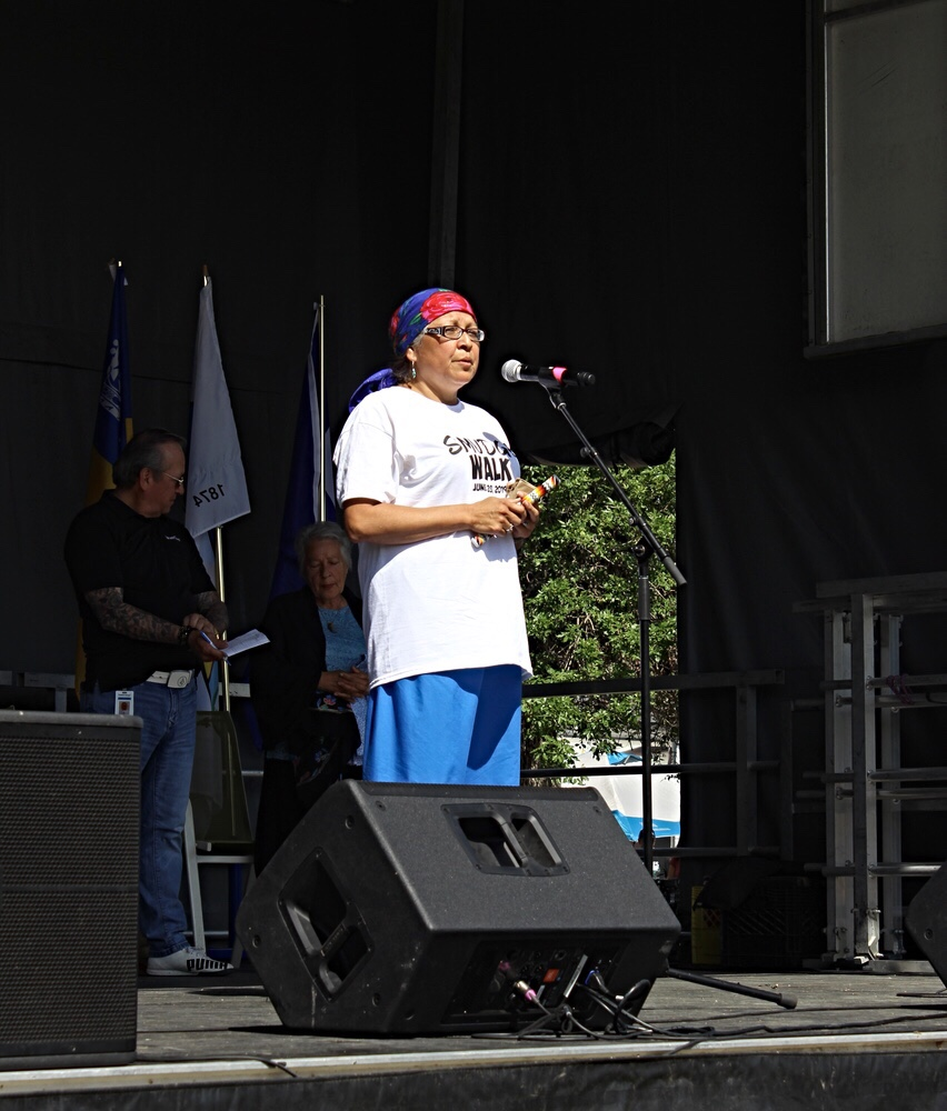 Margaret Kisikaw Piyesis of All Nations Hope speaks during the opening remarks at the Smudge Walk in Dewdney Park.