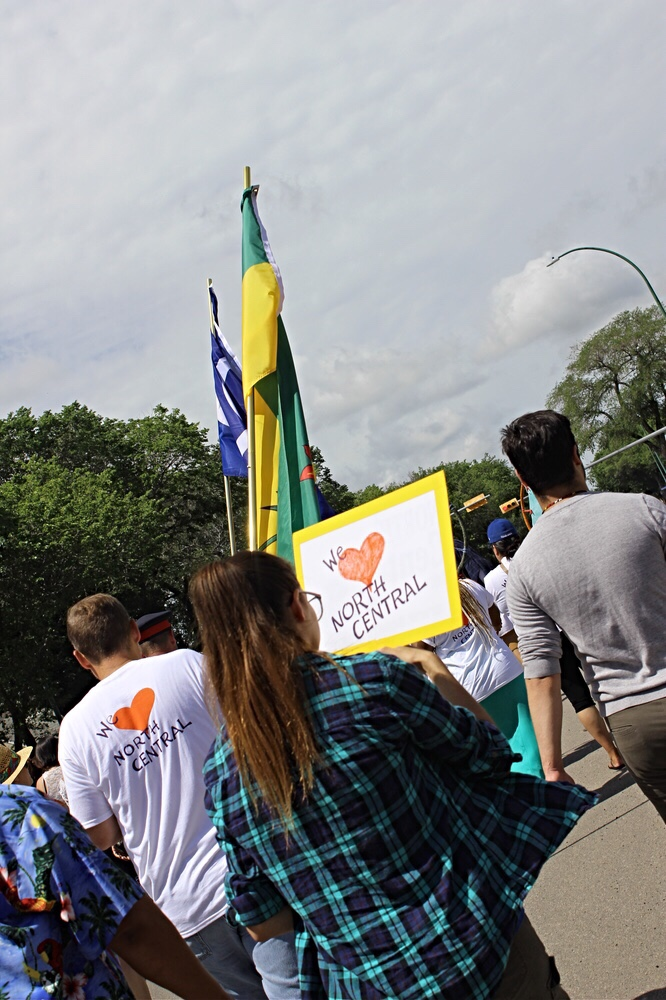 Particiapnts walk down the steet carrying flags and homemade signs during the annual Smudge Walk in Regina