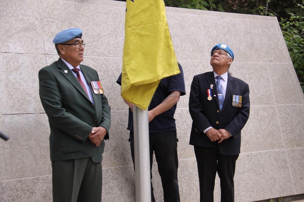 Veterans helped raise the flag.