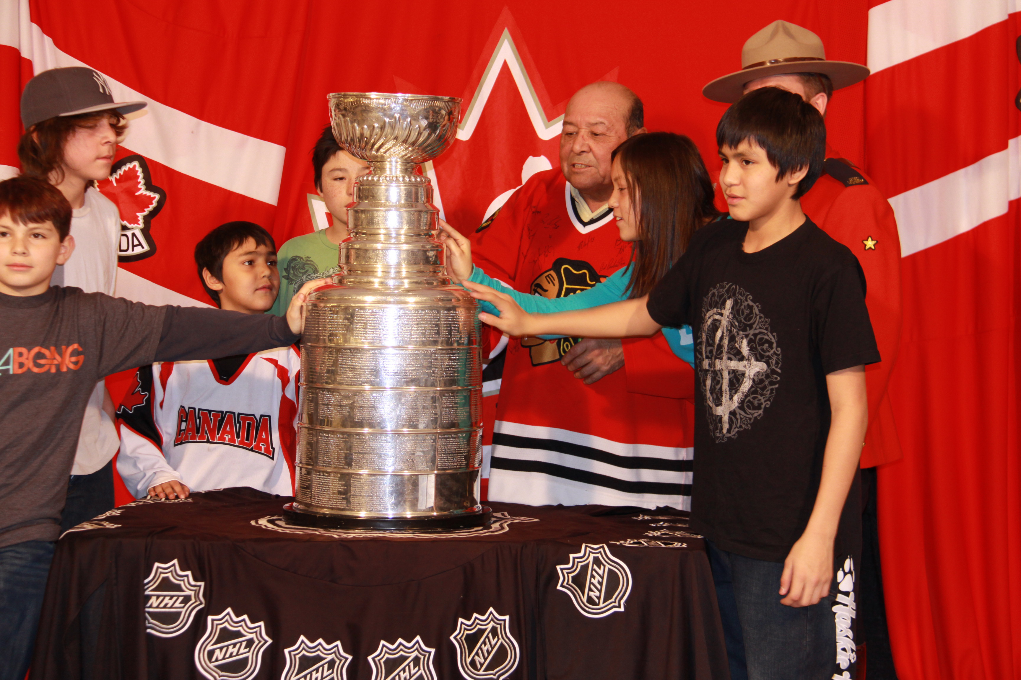 Freddy with his grandkids visiting the Stanley Cup