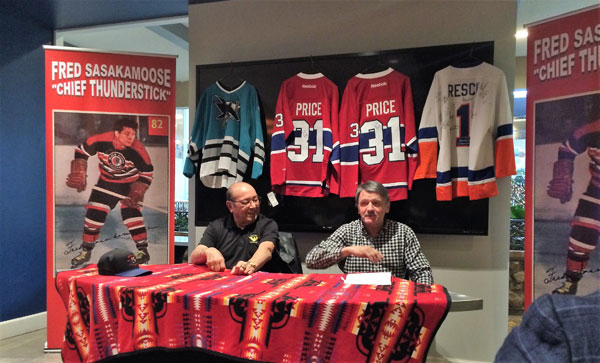 Fred Sasakamoose, left, and Chico Resch announcing the 2nd annual Chief Thunderstick Hockey Tournament later this month.