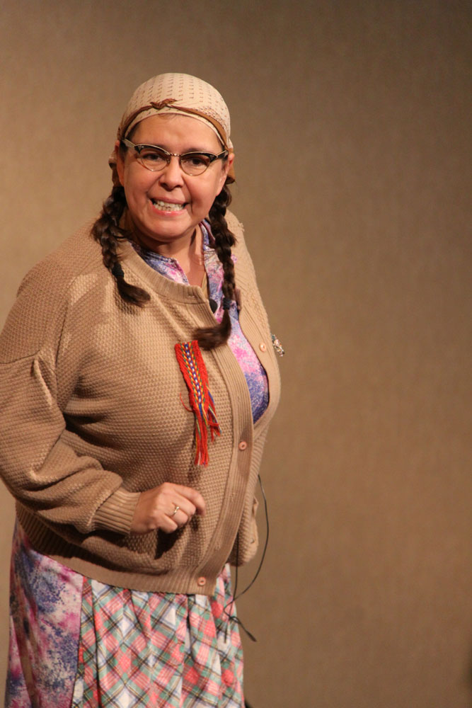 Can't be serious all the time: Ernestine made the conference crowd laugh with her antics.