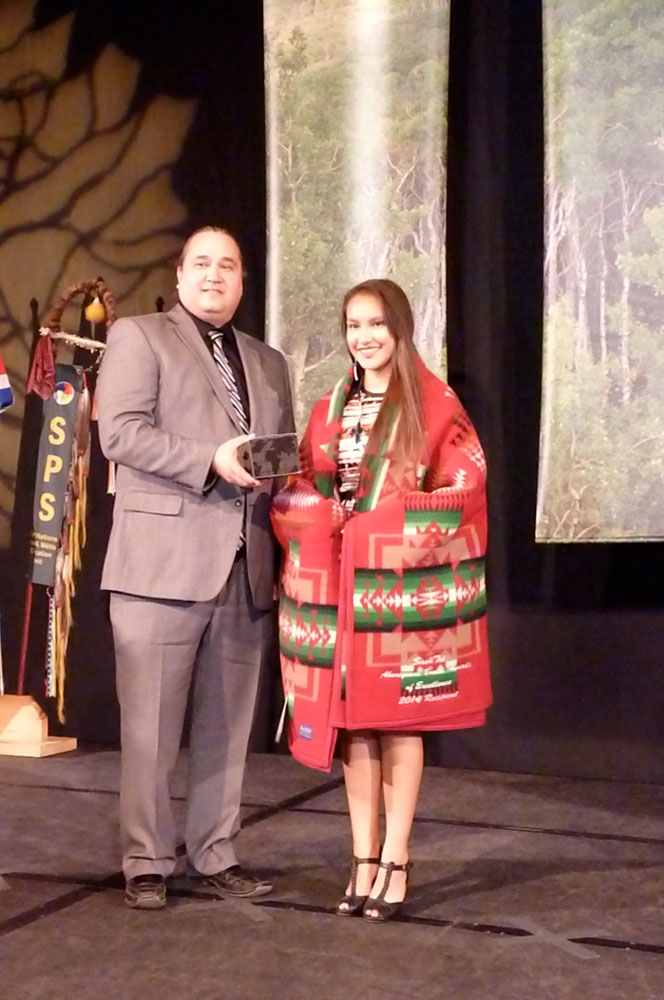 Lionel Tootoosis, Vice President SIGA, presents the Culture Award to Prairie Littletent.