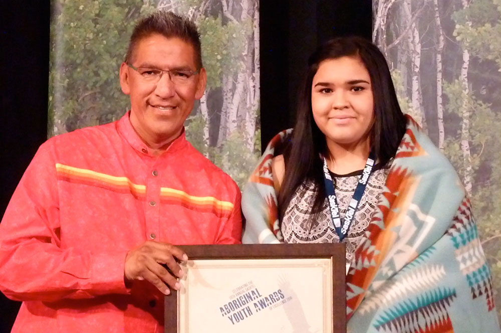 Lyle Daniels, Saskatchewan Building and Trades, presents the Leadership Award to Summer Michel-Stevenson.