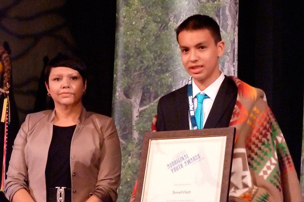 MLA Jennifer Campeau, Government of Saskatchewan, presents the Spirit Award to Terrell Flett.