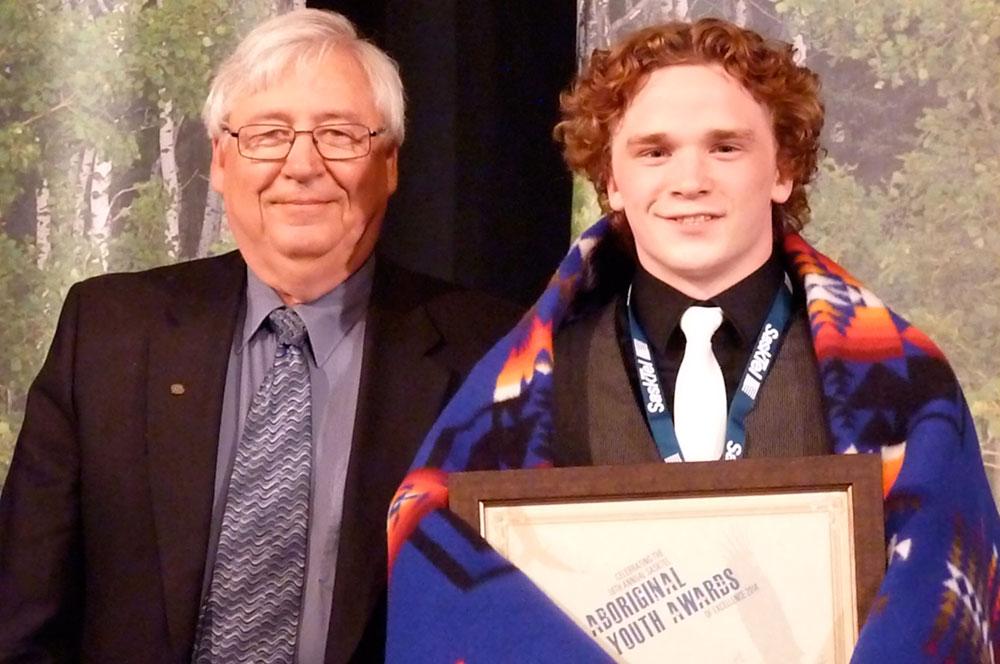 Jerry Shoemaker, SaskSport, presents the Sports Male Award to Josh Bodnarchuk.