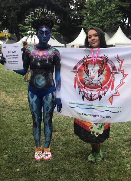Artist brushes body paint on world stage
