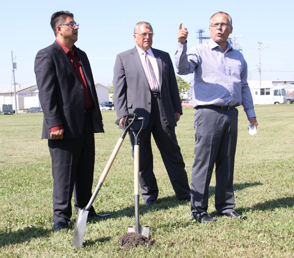 MLCN Investment Mgmt Corp General Manager Paul Ledoux points out where the new building is going to Muskeg Lake Cree Nation Chief Cliff Tawpisin Jr.  and Mayor Atchison.