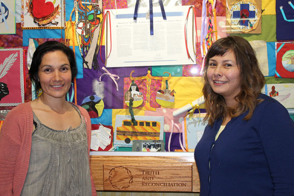 Balfour Collegiate Cree teacher Tammy Ratt (left) and the school's Indigenous Advocate Rhonda Stevenson stand proudly in front of one of many ribbon project installations. Ratt and Stevenson helped to organize this school project.