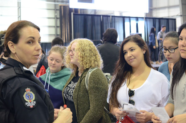 Marissa Thomson (left) listens to a Sargent at the RPS table at Stepping Stones Career Fair.