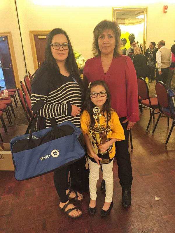 3rd place winner McKenna Fineblanket with her mom, Brittney Olsen, and FNPSP President Pauline Favel.
