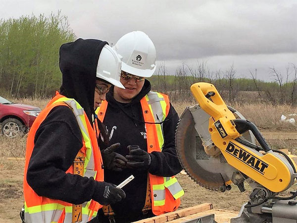 Students earn high school credits and construction worker skills while First Nations get badly needed homes.