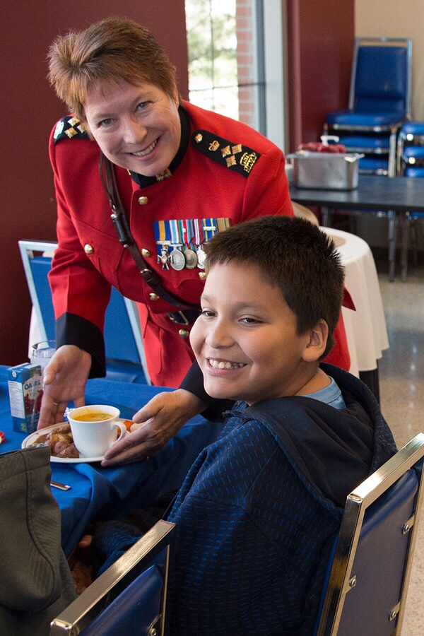 RCMP Depot Division Commanding Officer Brenda Lucki serves Jordan Ermine as tradition demands.