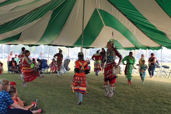 Girls and women danced in the red dress jingle special to honour missing and murdered Indigenous women in this year's Tony Cote Welcome Back powwow.