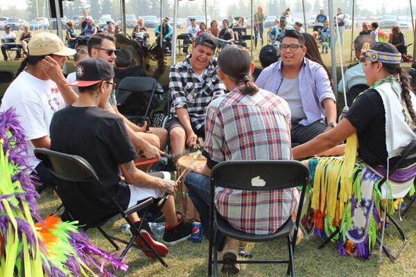 Drummers sing the afternoon away on September 7th at the FNUniv Tony Cote Welcome Back powwow.