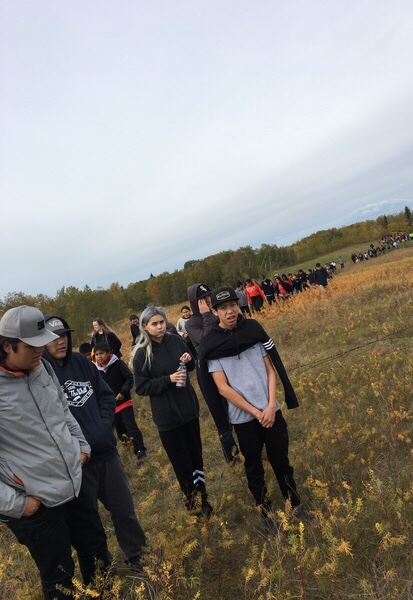 Students and community members walked to the Battleford Industrial School Cemetery for a moment of silence and to recognize those that are buried there.