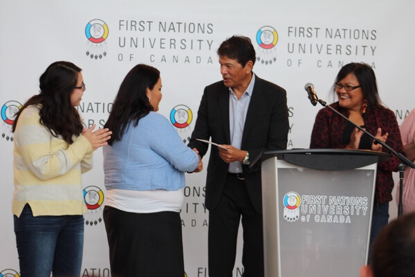 Ted Nolan presenting the scholarship donation cheque to FNUniv student president Lucy Musqua. (L-R): Shay Pelletier, Lucy Musqua, Ted Nolan, Sherri Kaiswatum.