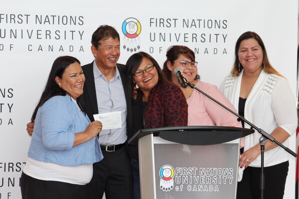 Ted Nolan presenting cheque to FNUniv to help Indigenous women students succeed pursuing their degrees. (L-R): Lucy Musqua, Ted Nolan, Sherri Kaiswatum, Keisha Desjarlais, Cherish Jean-Baptiste.