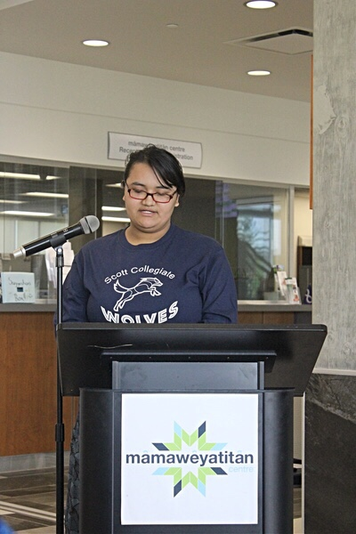 Olivia Isnana, a grade 11 student at Scott Collegiate, gives a speech during the flag raising ceremony at mâmawêyatitân centre on Tuesday, June 4, 2019 before hoisting the Treaty 4 and Metis flag.
