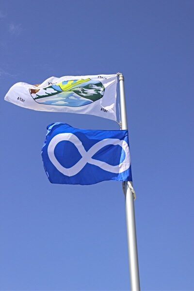 The Treaty 4 and Metis flag fly at the mâmawêyatitân centre.