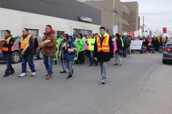 The vigil marched through parts of downtown Saskatoon.