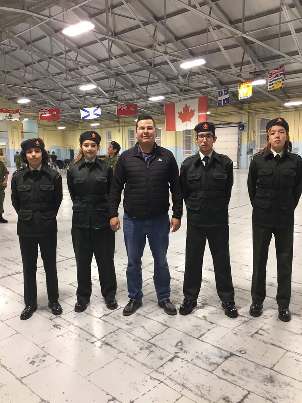 Principal and education director Simon Bird stands proudly with a few cadets from his school in Montreal Lake Cree Nation.