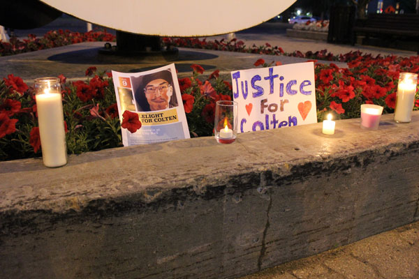 The Regina Peace Fountain in front of the City Hall was lit with candles to honour and remember the life of Colten Boushie, 22, who was fatally shot a year ago on a Saskatchewan farm.