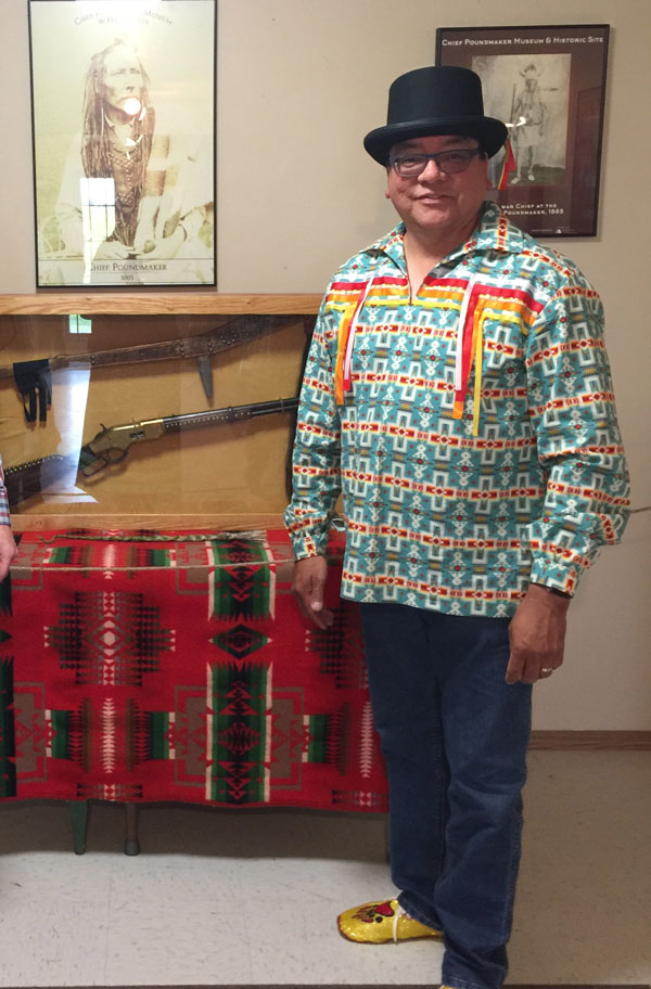 Band councillor Milton Tootoosis, stands in front of Chief Poundmaker's gun and ceremonial staff in the Poundmaker Cree Nation museum on July 18. The belongings were on loan from Parks Canada for short exhibit. Tootoosis helped draft a letter to the Prime Minister asking for Poundmaker's exoneration.