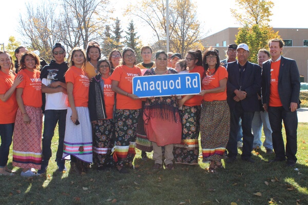 The Anaquod family pose proudly holding a street sign that was gifted from Regina Mayor <Br>Michael Fougere.