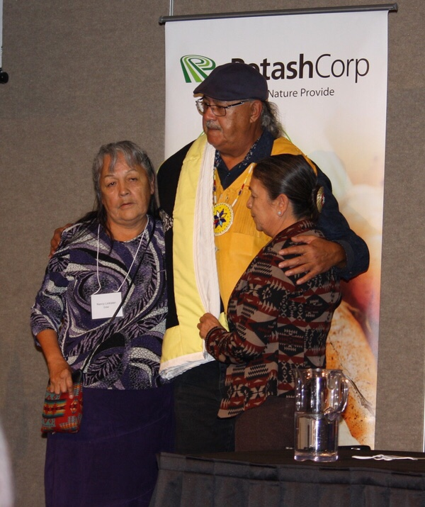 Eugene Arcand, TRC member and Sask representative for national survivor committee, presented with an honorary blanket during Wicihitowin Aboriginal Engagement Conference.