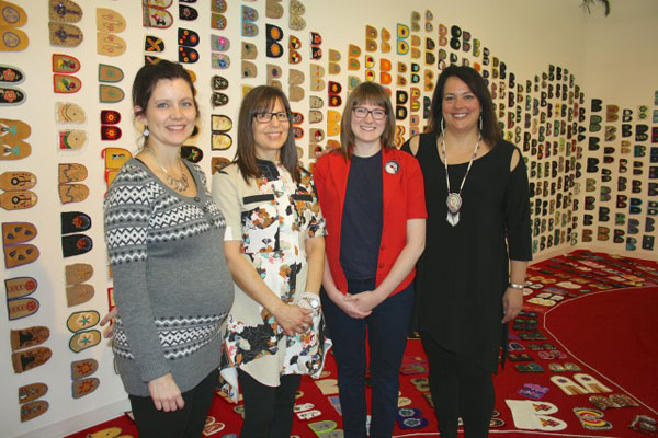 Danette Exner, Judy Anderson, Katherine Boyer and Racelle Kooy. Kooy is the keeper of the exhibit while it is in Regina.