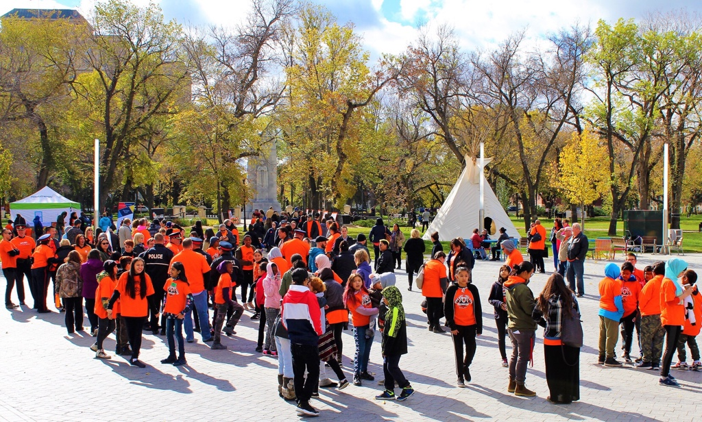 Hundreds of people gathered in downtown Regina to celebrate Orange Shirt Day.
