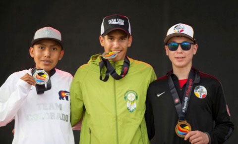 Bauman (centre) with his gold medal for the U16 3-kilometre cross country event. He always makes a point of shaking his competitors' hands after each race, something that makes his mom proud.
